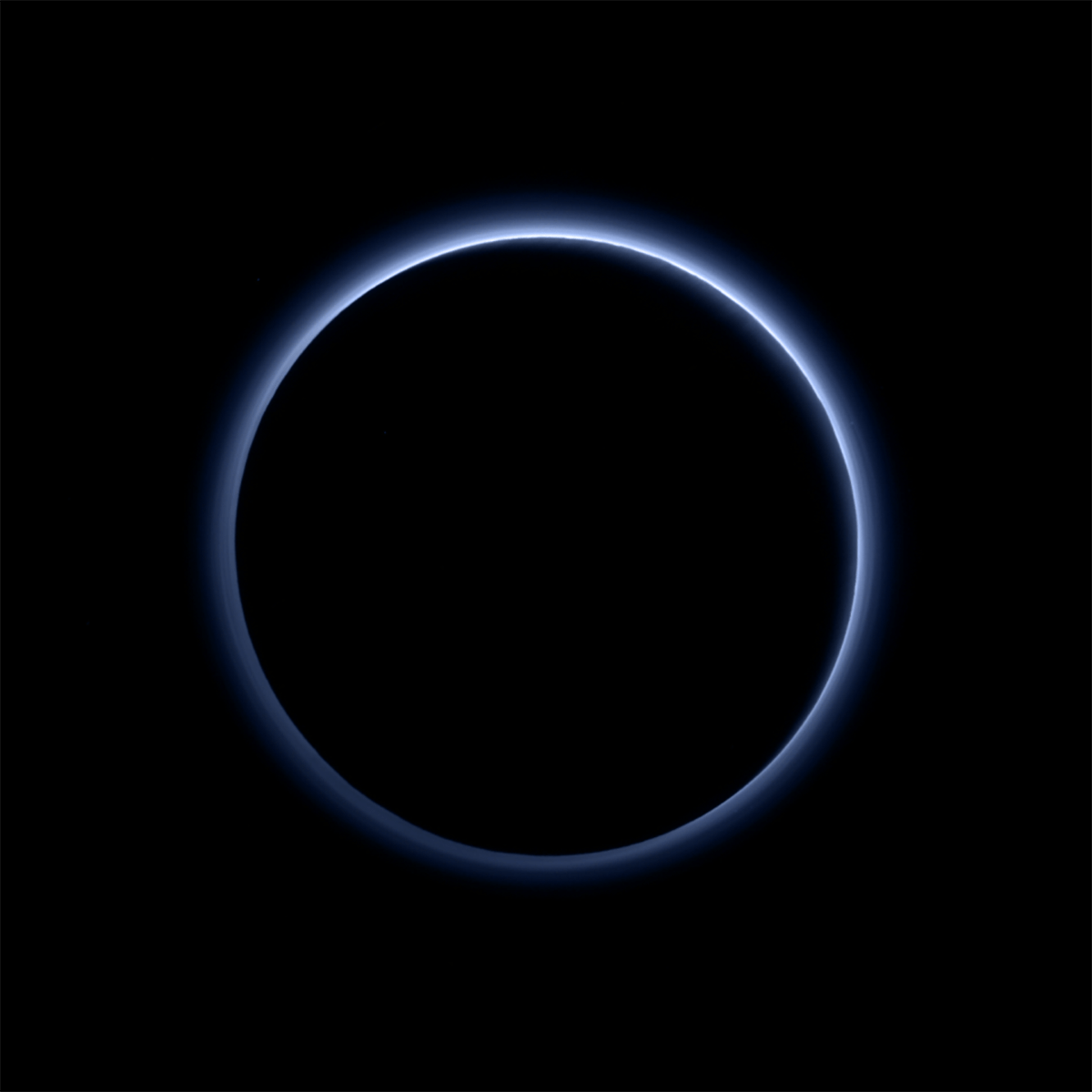 Pluto's Blue Sky: Pluto's haze layer shows its blue color in this picture taken by the New Horizons Ralph/Multispectral Visible Imaging Camera (MVIC). The high-altitude haze is thought to be similar in nature to that seen at Saturn's moon Titan. The source of both hazes likely involves sunlight-initiated chemical reactions of nitrogen and methane, leading to relatively small, soot-like particles (called tholins) that grow as they settle toward the surface.  Credits: NASA/JHUAPL/SwRI