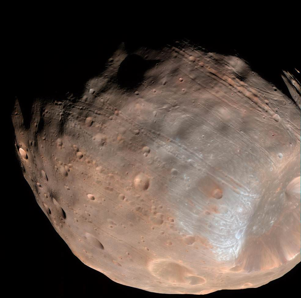 New modeling indicates that the grooves on Mars' moon Phobos could be produced by tidal forces – the mutual gravitational pull of the planet and the moon. Initially, scientists had thought the grooves were created by the massive impact that made Stickney crater (lower right). Credit: NASA/JPL-Caltech/University of Arizona