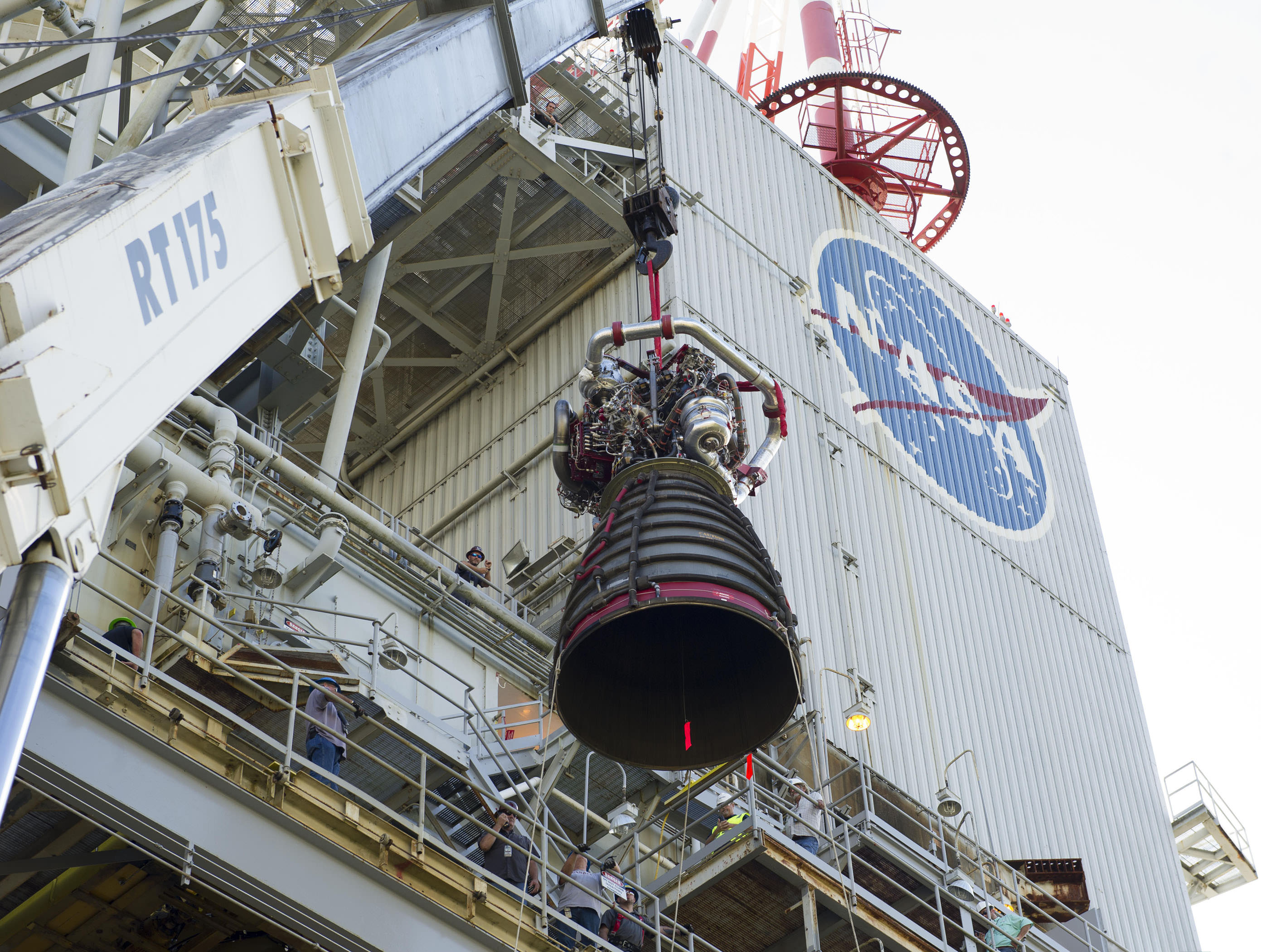 The first RS-25 flight engine, No. 2059, is placed on the A-1 Test Stand at Stennis Space Center, Miss. The engines were built by Aerojet Rocketdyne and are being tested in 2015 and 2016 to certify them to fly on NASA's new Space Launch System (SLS) rocket.  SLS-1 will launch on its first uncrewed mission in 2018. Credit: NASA