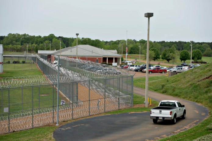 Fencing surrounds the Walnut Grove Correctional Facility in Walnut Grove, Mississippi, U.S., on Wednesday, April 17, 2013. In Mississippis four privately run prisons last year, the assault rate averaged three times as high as in state-run lockups. None was more violent than the Walnut Grove Youth Correctional Facility. Photographer: Daniel Acker/Bloomberg via Getty Images