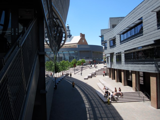 Main Street at the University of Cincinnati, with the Campus Recreation Center (left) by Morphosis and KZF Design, Tangeman University Center (center) by Gwathmey Seigel Kaufman and GBBN Architects, and the Steger Student Life Center (right) by Moore Ruble Yudell and Glaserworks. [David Cole]