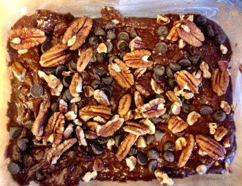 Ready for the oven topped with bittersweet chocolate chips and pecans.