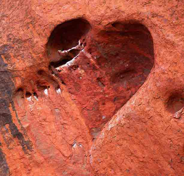 getty-heart-shaped+cave+etched+by+wind+and+water+adorns+the+face+of+Ayers+Rock