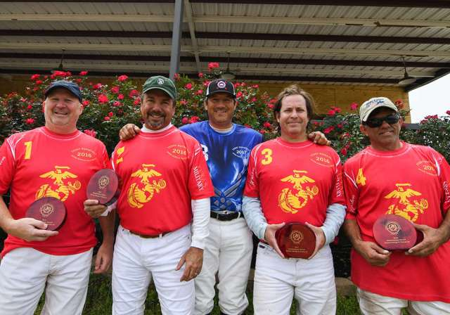Marine Corps, 2018 USPA Southwestern Circuit General George S. Patton, Jr. champions (L to R) Kyle Brown, Fabian Vela, Cuatro Tolson, and Lalo Ramirez pictured with Pud Nieto.
