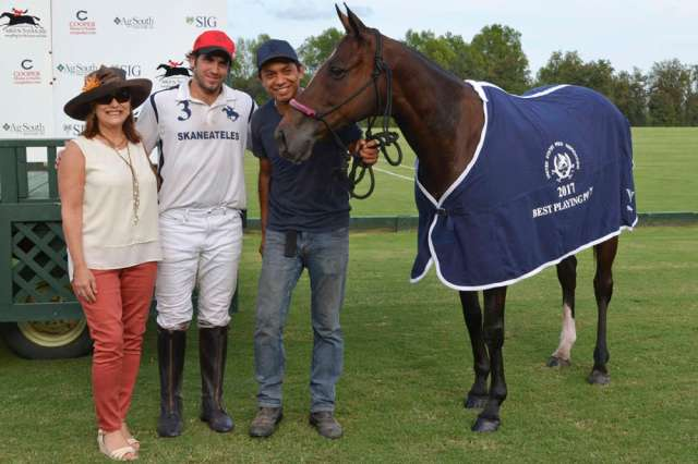 Best Playing Pony Fancy owned and ridden by Mariano Obregon, presented by Brenda Lynn and pictured with Marcos Esquivel.