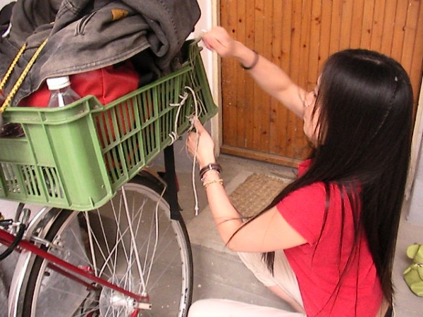 Japanese traveler helping load my bicycle in Hungary