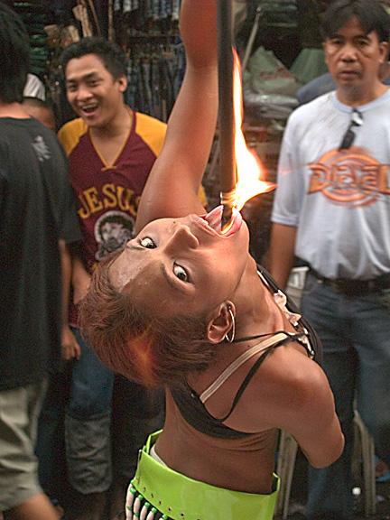 Fire eater at the Black Nazarene Festival in Manila