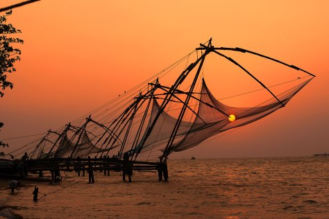 Chinese fish nets at sunset in Fort Cochin (Kochi) in Kerala, In