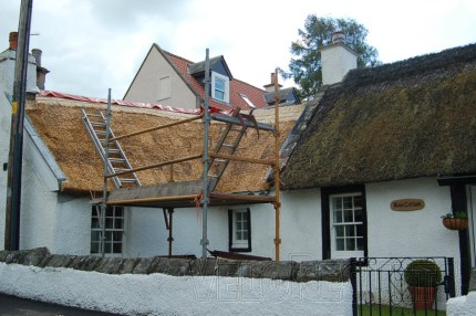 A beautiful thatched roof is restored.