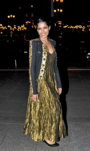 In a Ralph Lauren gown and Balmain jacket at the L'Oreal Paris 40th Anniversary Party, 2011