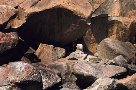 A giant Nandi statue nestled among the boulders
