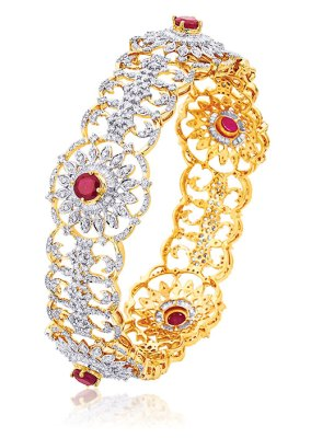 Ruby studded diamond bangle, in 18-carat gold
