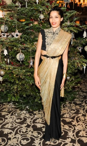 In an Anamika Khanna Couture sari-gown and Gucci belt, 2013
