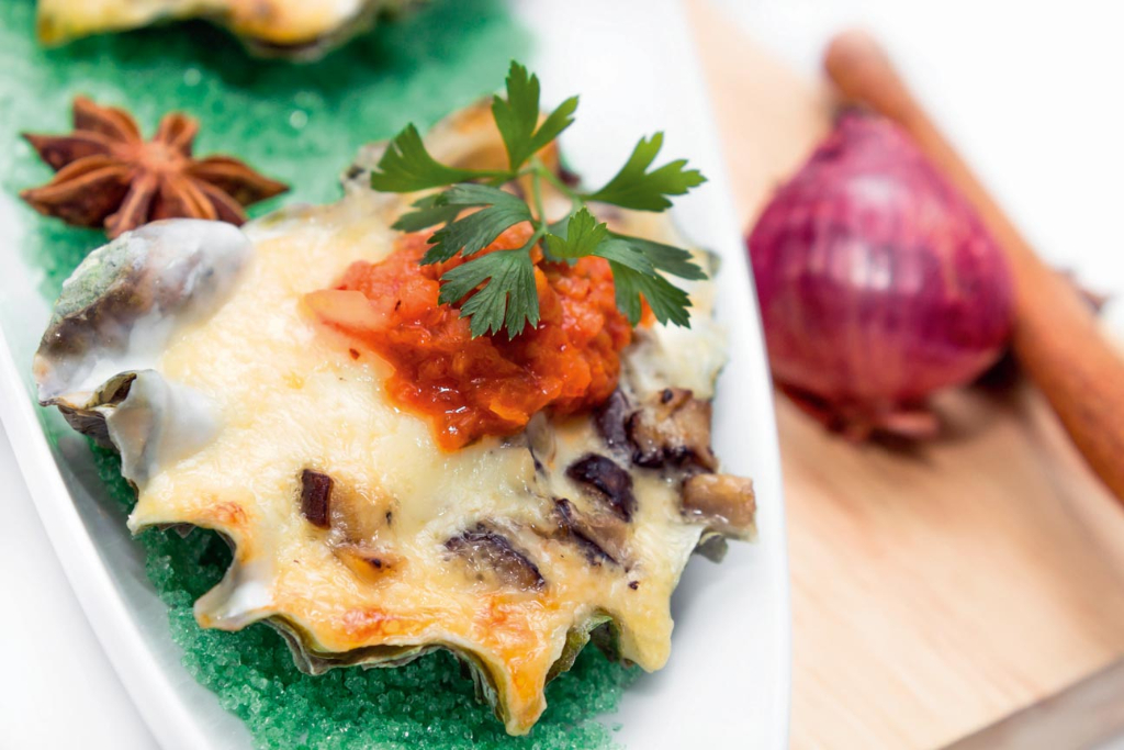 Baked oyster shell with cheese