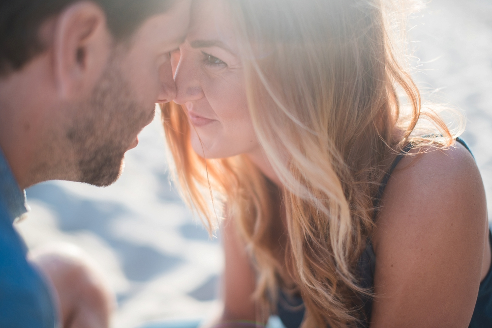Bright and airy beach engagement picture by an orange county wedding photographer