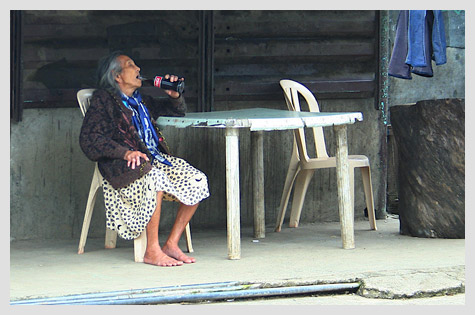 old woman drinking Coke