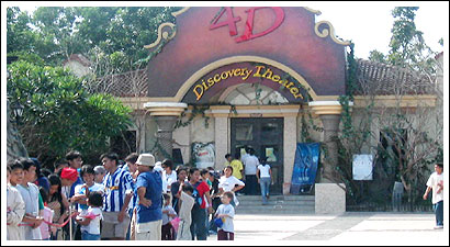 4D theater and people lining up for Raging Rapids