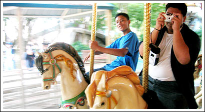 Rene trying to take my picture, and Joseph riding his horse