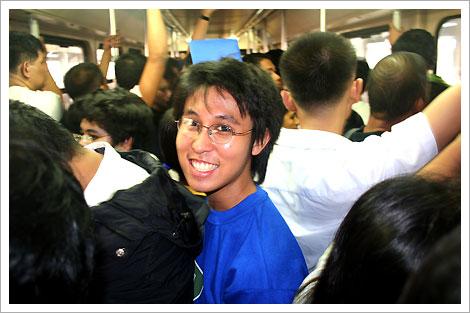 Joma inside a crowded LRT 1 coach, Manila