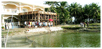 the NEW de Venecia mansion beside one of their fish ponds