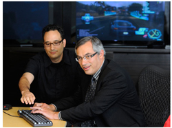 Minister Clement playing NFS at EA Canada in August 2010. Source: Richard Lam
