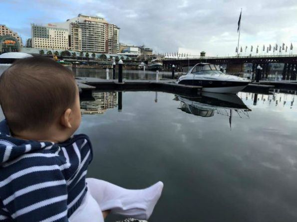 Oli looking at a boat