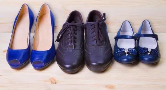 Three pair of shoes isolated on wooden background