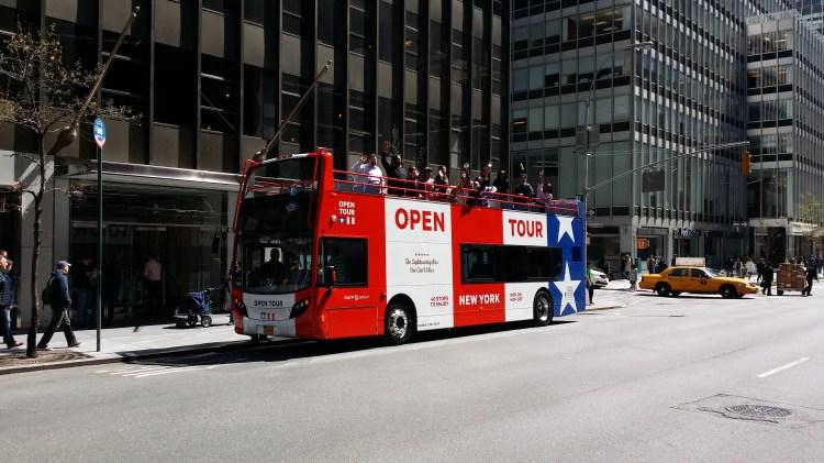 Bus with waving team members