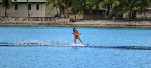 Charline wake boarding with the help of Roger and Sasha, the kind owners of Ednbal