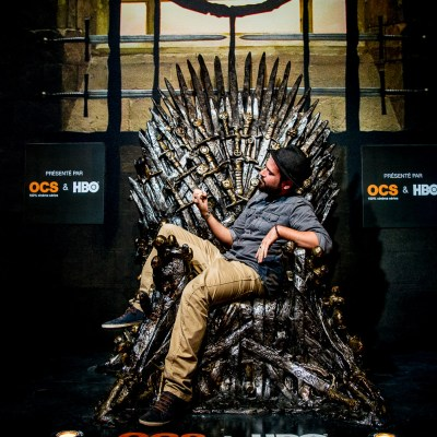 Séb sitting on the iron throne at the Game of Thrones exhibit - Paris, France