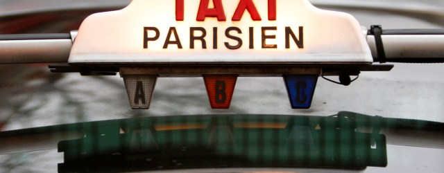 The top of a taxi is seen in downtown Paris January 29, 2008. Taxi drivers will stage on Wednesday a protest in the centres of France's major cities. The National Taxi Owners Federation is fighting against a scheme to solve the country's chronic shortage of taxis by the abolition of tight quotas and the authorisation of minicabs.     REUTERS/Charles Platiau (FRANCE)