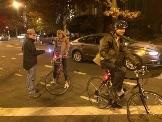 Phill helps to bicyclists riding at night without lights.
