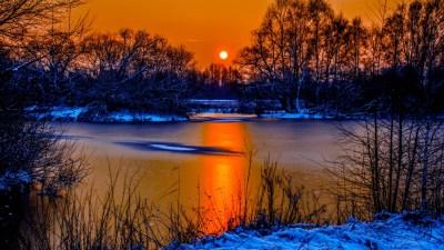 Sunset In Winter Snow River Coast Two Sun Orange Sky ...