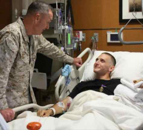 Egan, right, in the hospital with Gen. Joseph Dunford in summer 2012.