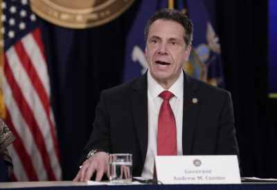 New York Gov. Andrew Cuomo signs executive order giving parolees in his state the right to vote ...