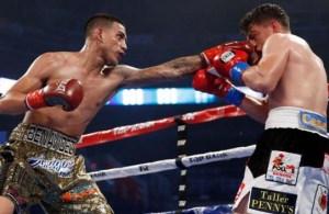 Benavidez TKOs Paez to retain title