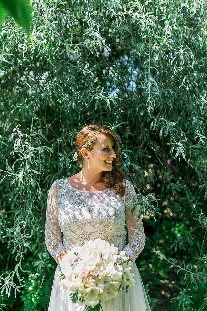 a watters wedding dress and maids in navy blue for a handmade and rustic barn wedding barn wedding dresses The bride wore a Watters wedding dress for her wedding at The Great Barn at Micklefield
