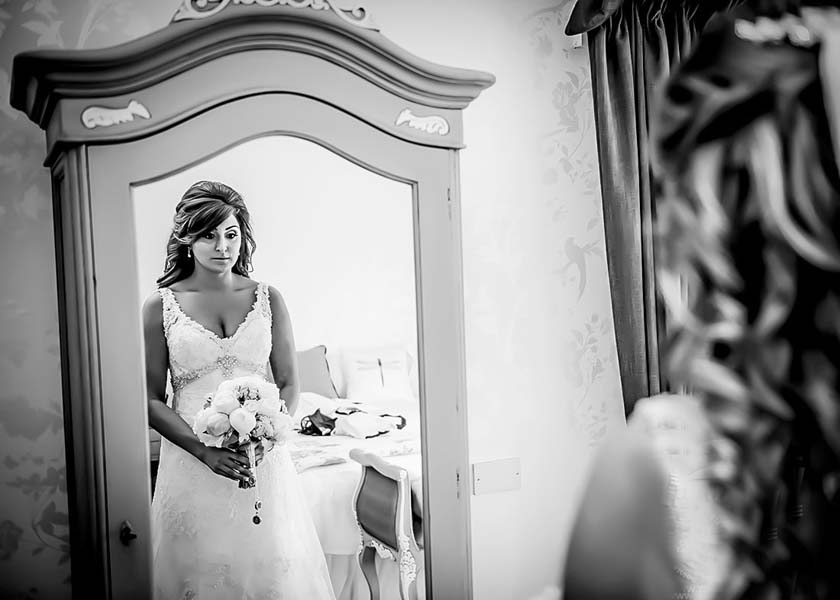Bride looking in mirror Stirk House Hotel