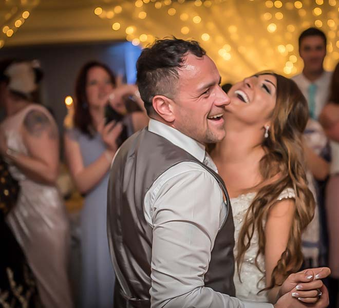 Bride and groom laughing at Stirk House Hotel