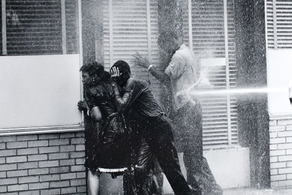 Student civil rights protesters blasted with water hose by authorities, Birmingham, Alabama, 1963