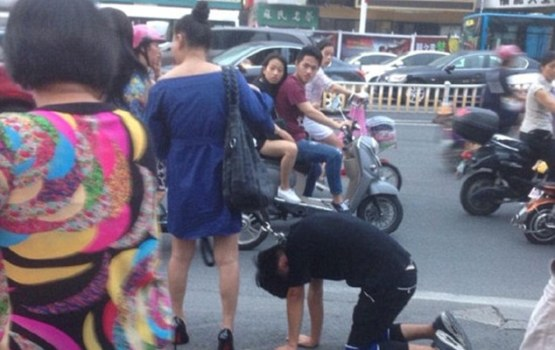 Chinese Woman Takes Man For Walk On A Leash