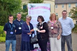 The Coalition Group's Beryl Noyce (pictured third from left) presents a cheque to Pembrokeshire Youth Bank member, Bryani Kelly outside County Hall, Haverfordwest. With them, from the left, are: Dayle Gibby (youth engagement worker); Steve Davis (Pembrokeshire Youth service manager); Rose Davis (Children and Young People's Rights officer) and Lee Hind (PAVS).