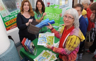C.C.C recycling team in St Elli Centre to promote recycling for Recycling Week. Veronica Haines from Pwll picks up blue Bags and a food bin plus recycling advice from C.C.C officers Karen Fulham and Caroline Davies. Pic Jeff Connell 17/08/15
