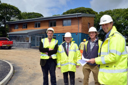 Pictured outside the new building are, left to right: Andrew Vaughan-Harries, Gwyn Evans (County Council European Manager); Haydn Boyce (site manager) and Jamie Edwards (developer).