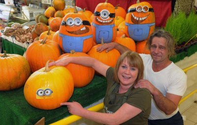 Llanelli Market stall has turned pumkins into Minions. Market traders Miriam and Steve Phillips show of their handy work.Pic Jeff connell 30/09/15