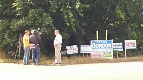Kiro7 news interviewing candidate Randy Ross about his signs being taken by incumbent Commissioner Frank Gordon