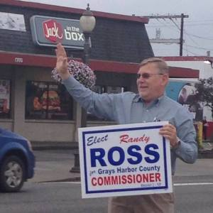 Randy Ross, the candidate running against Frank Gordon is holding the one campaign sign Commissioner Gordon can't take
