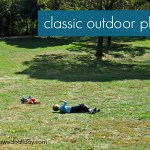 Classic Outdoor Fun: Rolling Down the Hill