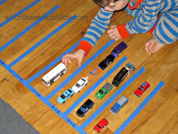 Kids who love toy cars and math will love this parking lot game.