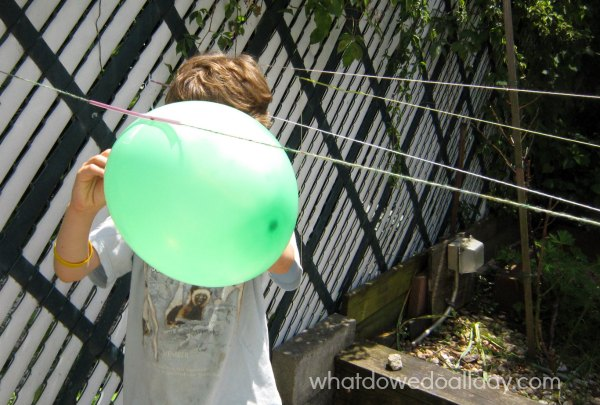 Balloon rocket experiment for kids. Summer science fun.